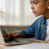boy working online to learn